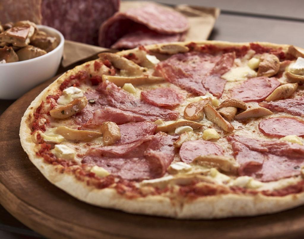 Fotografie culinară de detaliu cu Trenta Pizza din gama Artigianale.